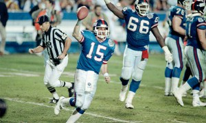 Quarterback Jeff Hostetler hoists the game-winning ball in Super Bowl XXV.